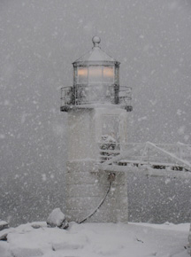Marshall Point Lighthouse in snowstorm