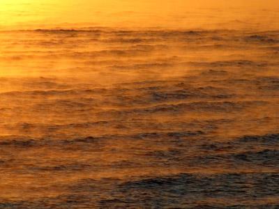 Sea smoke atop the bay