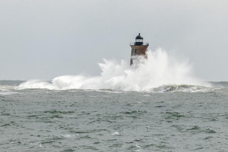 Waves crashing around Whaleback Lighthouse.