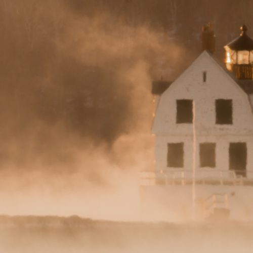 Rockland Breakwater Lighthouse surrounded by sea smoke