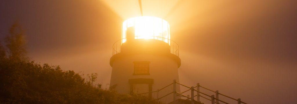 Owls Head Lighthouse shining through the fog