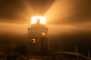 Owls Head Lighthouse shining into the fog