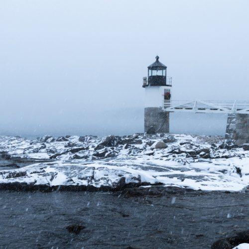 Snow swirls around the Marshall Point Lighthouse