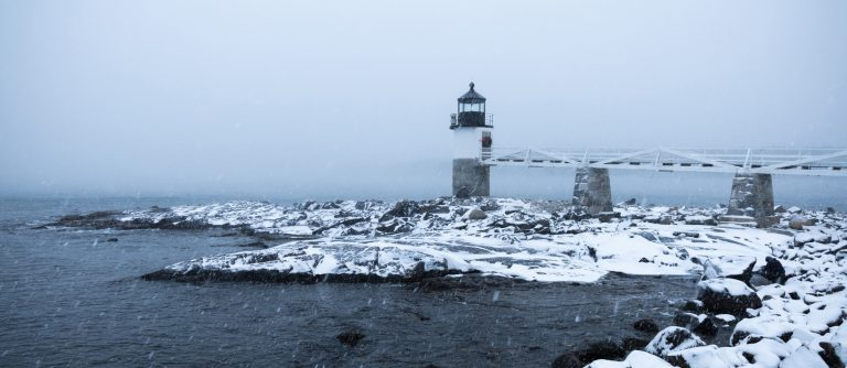 Snow swirls around the Marshall Point Lighthouse