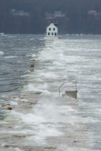 Storm waves crashing over the Rockland Breakwater Lighthouse